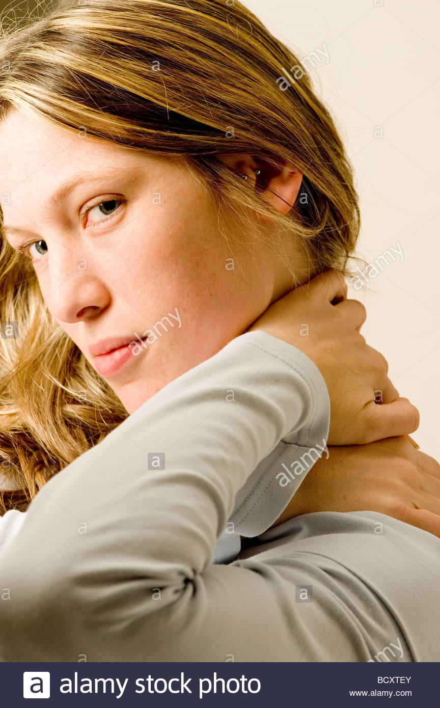 young woman, neck pains - Stock Image