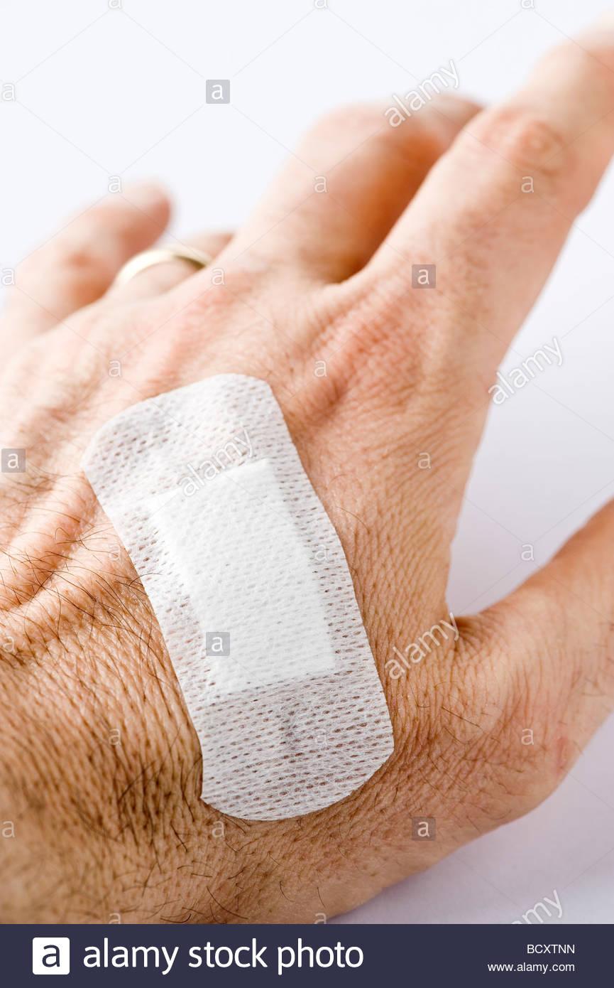 hand with adhesive bandage Stock Photo