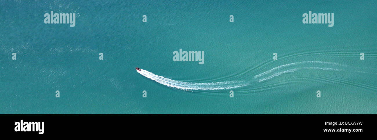 aerial shot of a RIB boat wake on a calm sea - Stock Image