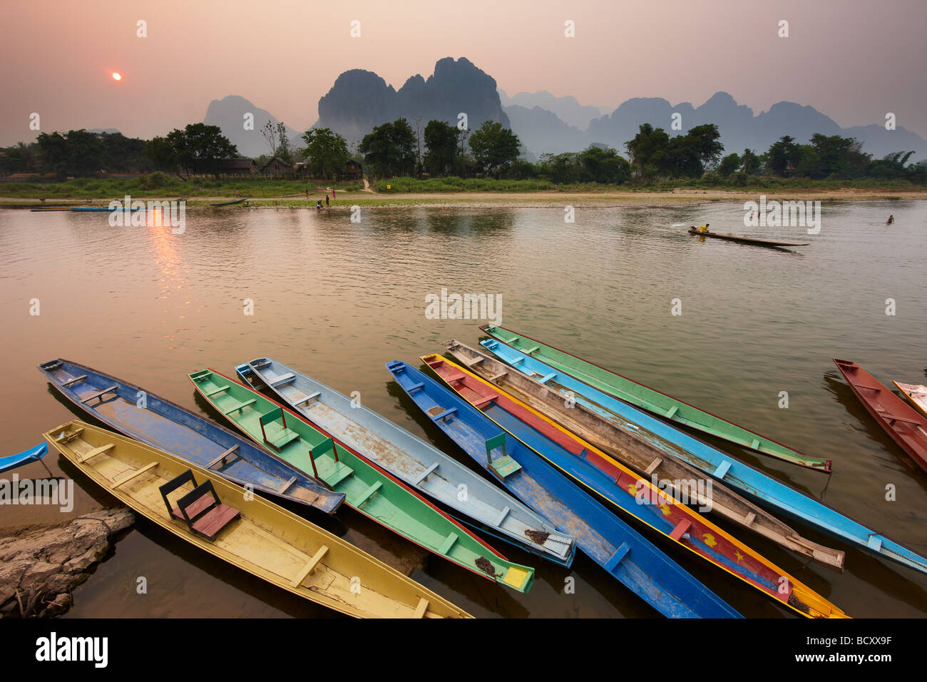 boats on the Nam Song River at Vang Vieng, Laos - Stock Image