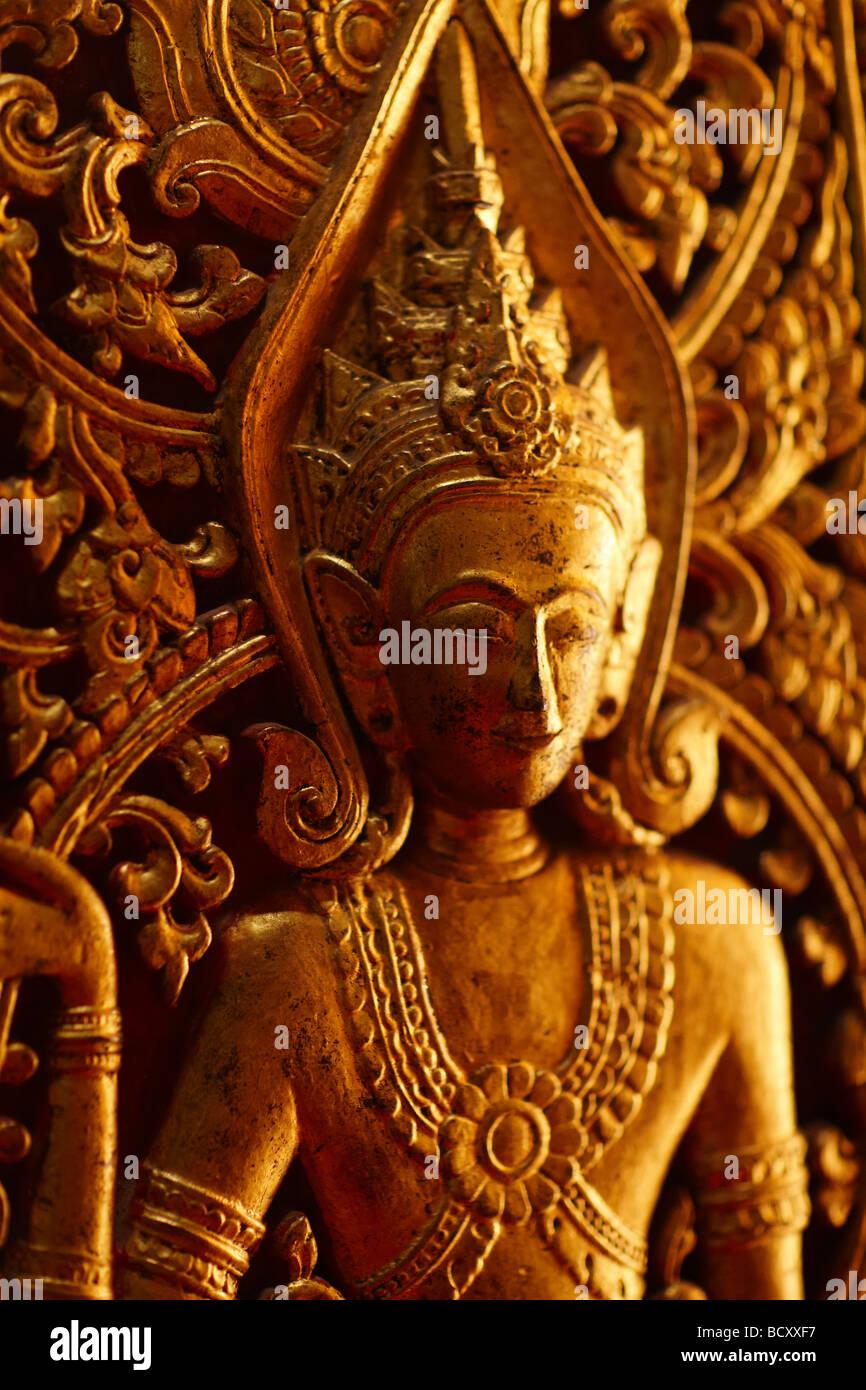 detail of gold doorway to Wat Mai, Luang Prabang, Laos - Stock Image