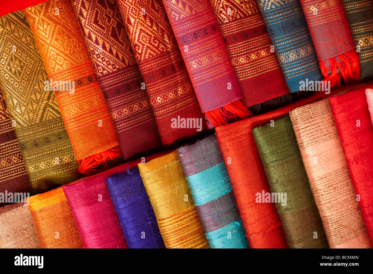 details of silk fabrics on sale in the Night Market, Luang Prabang, Laos - Stock Image