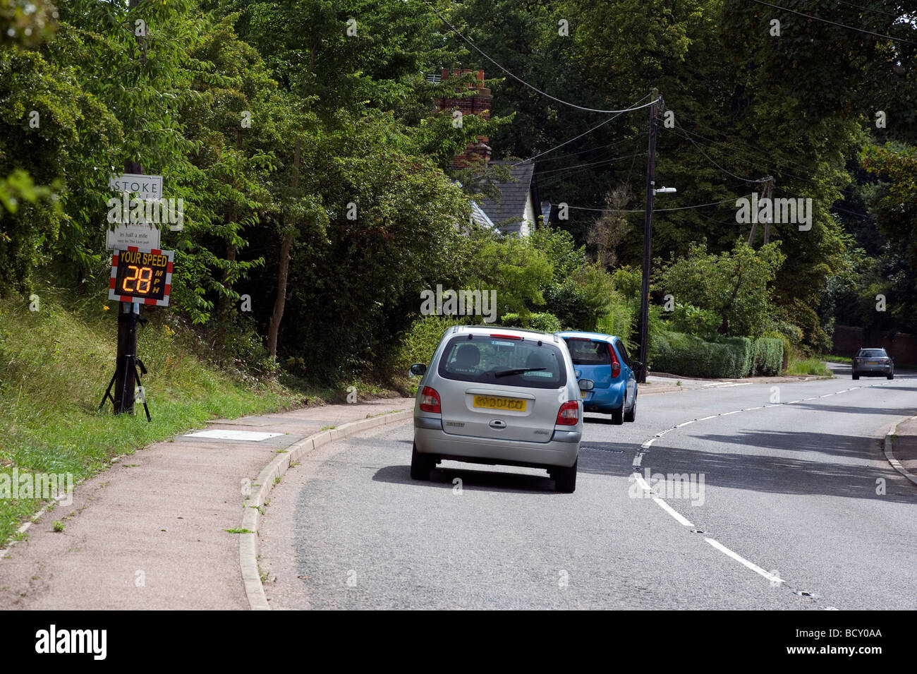 Smiley SID speed indicator device being used to help slow down trafic through the Suffolk village of Stoke by Clare - Stock Image