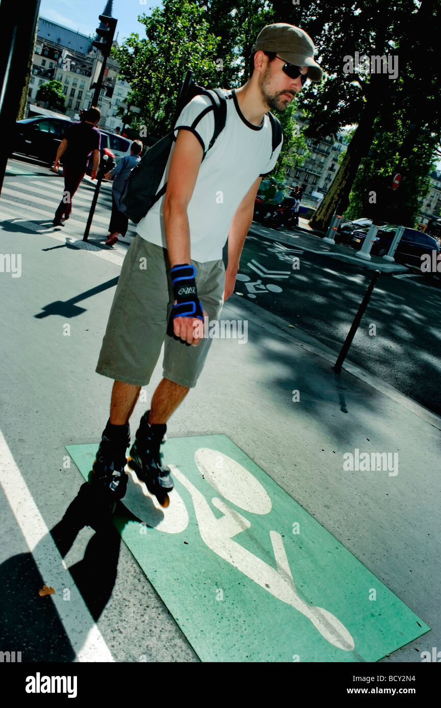 Paris France, French Young Man Roller Blading on Sidewalk Path, Street, adult extracurricular activities - Stock Image