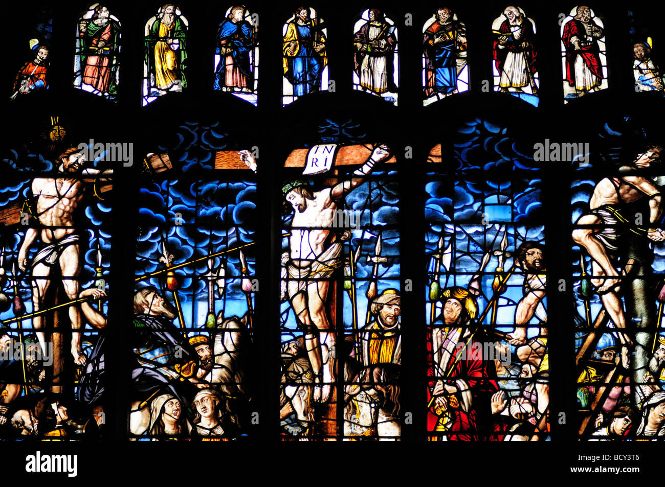 The East Stained Glass Window  depicting the cruxifiction in Peterhouse College Chapel, Cambridge England UK - Stock Image