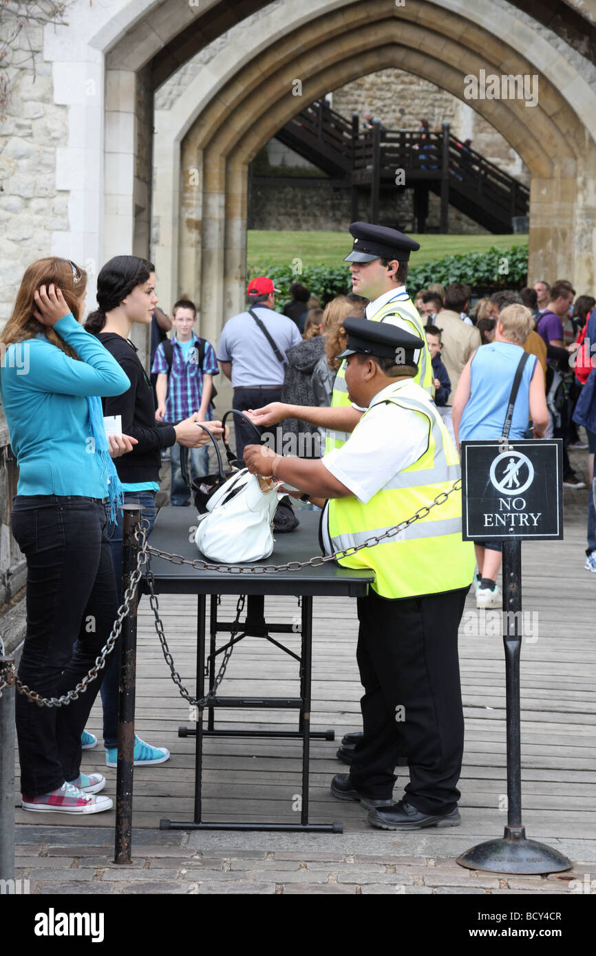 Bags being searched at a security point at the Tower of London, England, U.K. - Stock Image