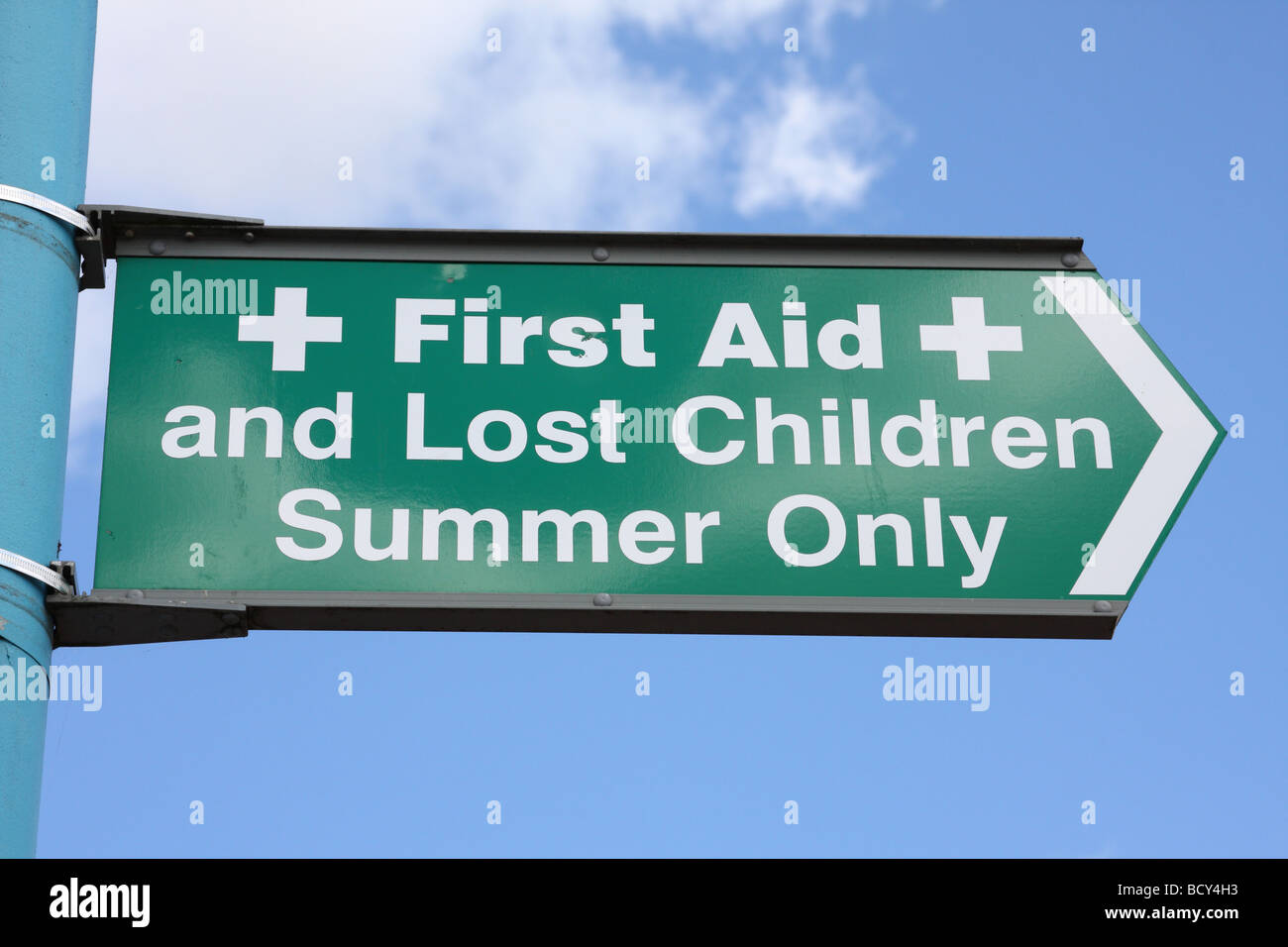 First Aid & Lost Children sign at an English holiday resort. - Stock Image
