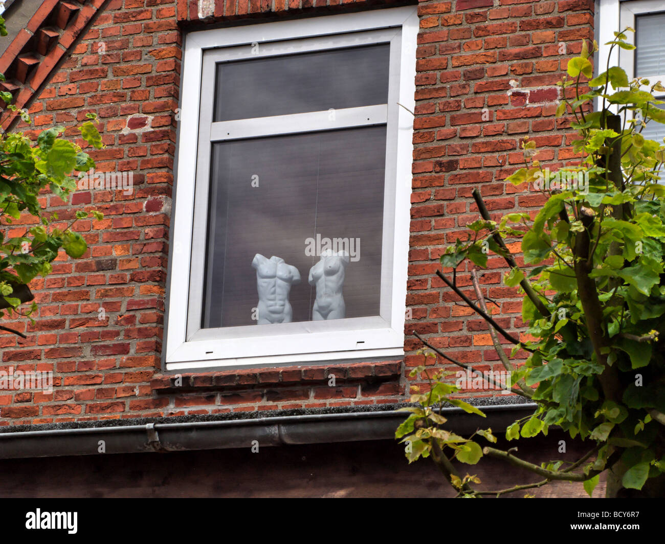 2 Headless Statues of the Human Anatomy in a Window in the Town of Wyk on the North Frisian Island of Fohr Germany - Stock Image