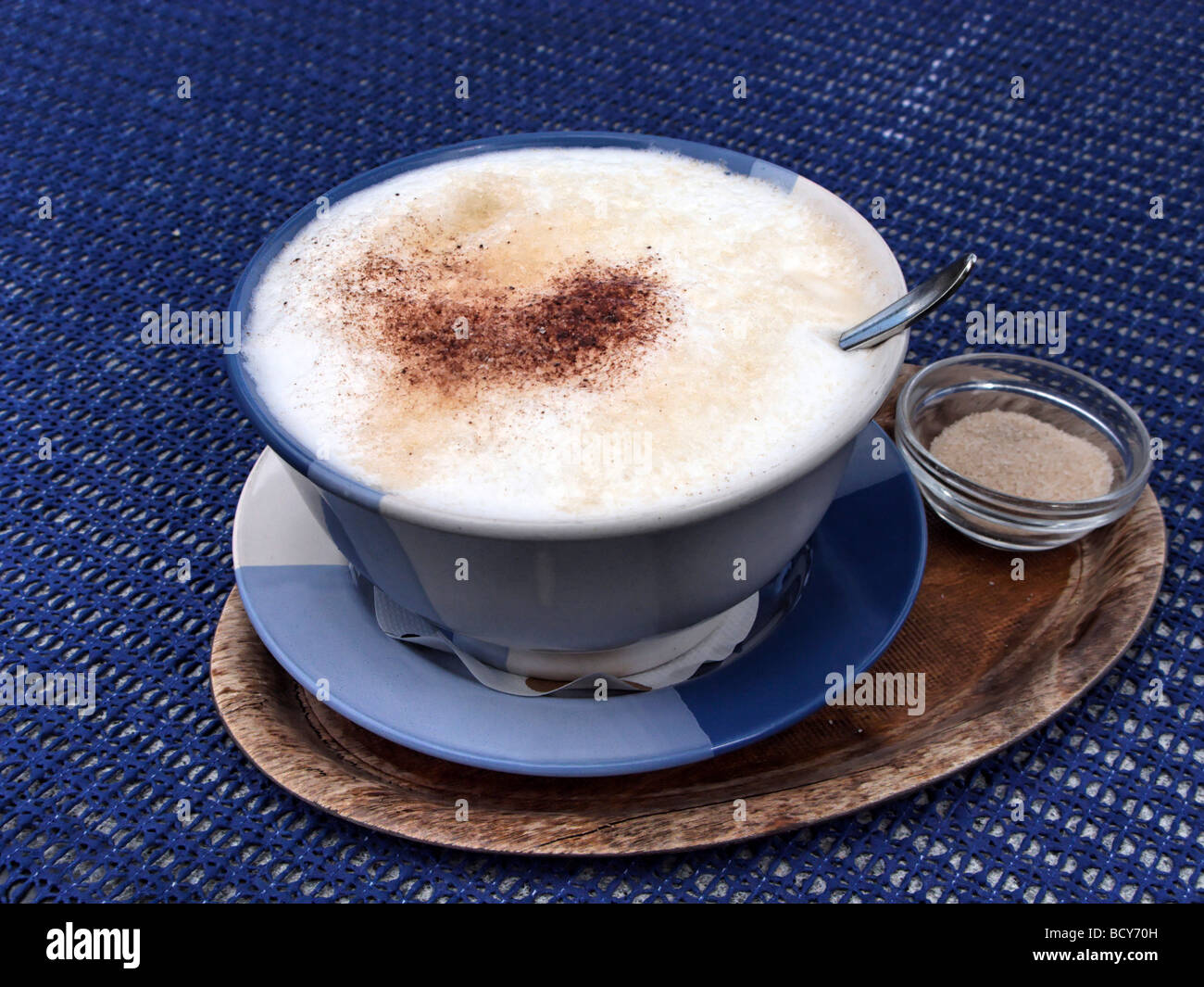 Milk Coffee with Cinnamon Spoon in Cup - Stock Image
