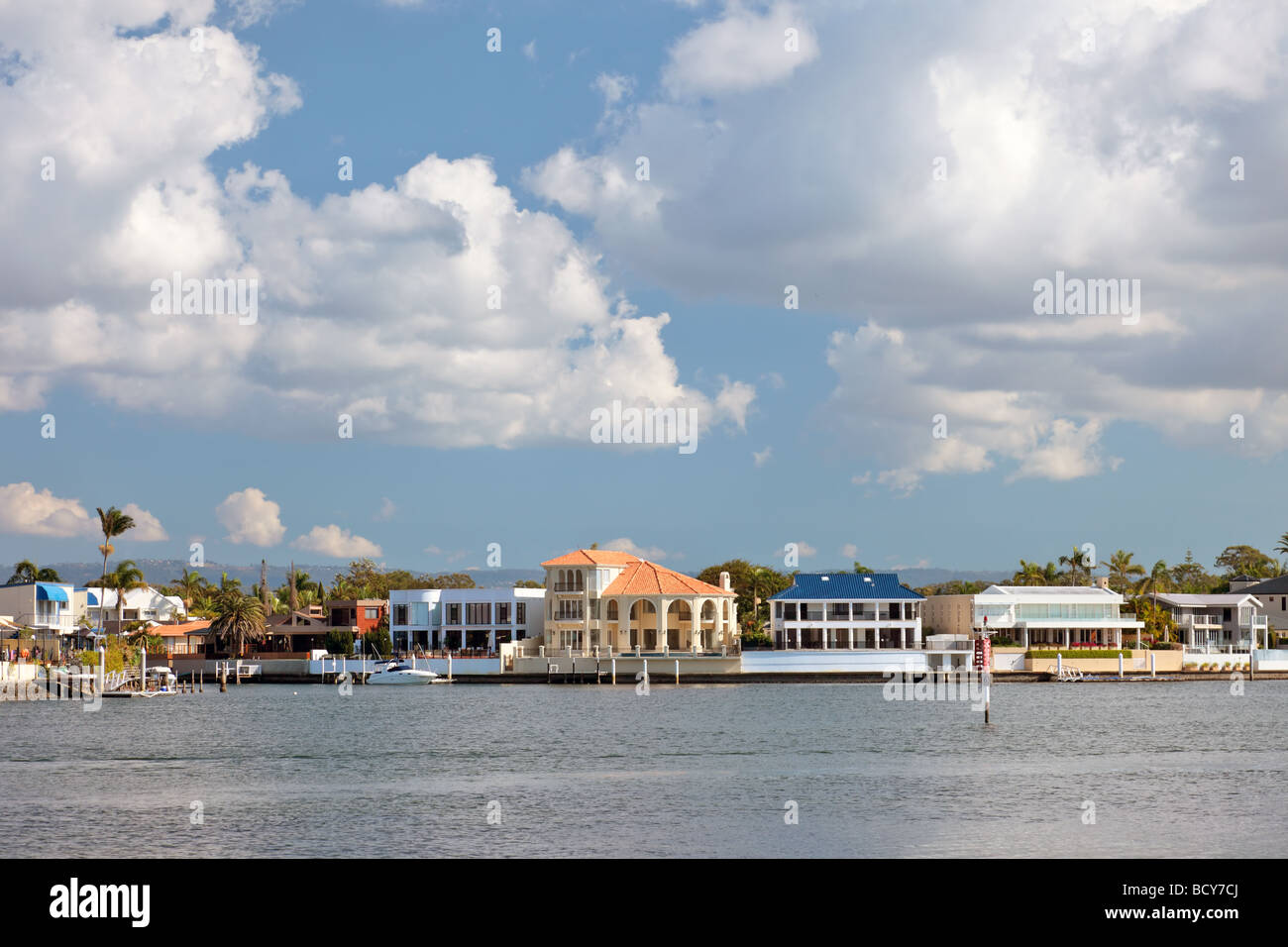 Waterfront homes fronting a river showing development in urban design Surfers Paradise Queensland Australia - Stock Image