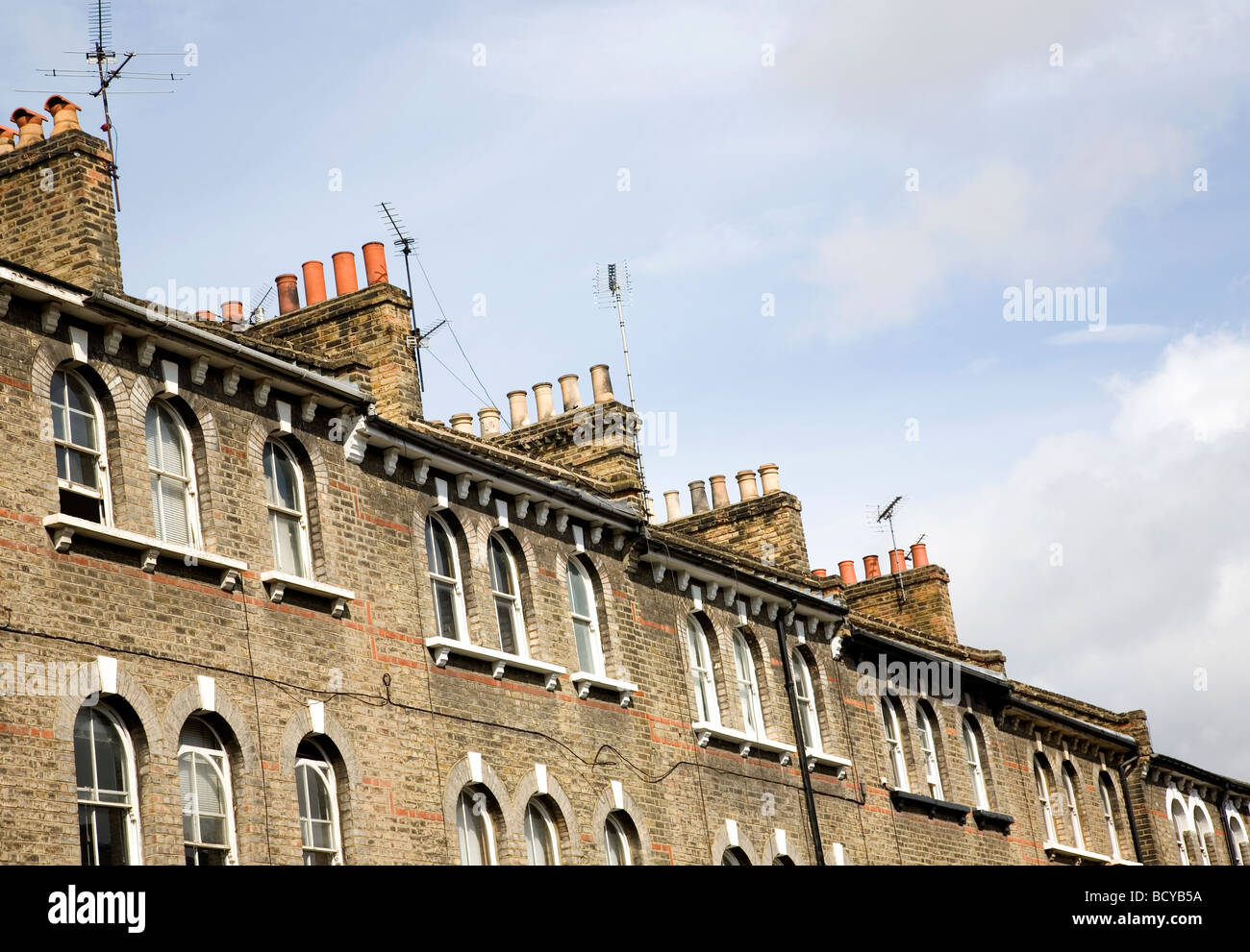 Victorian roof top chimneys - Stock Image