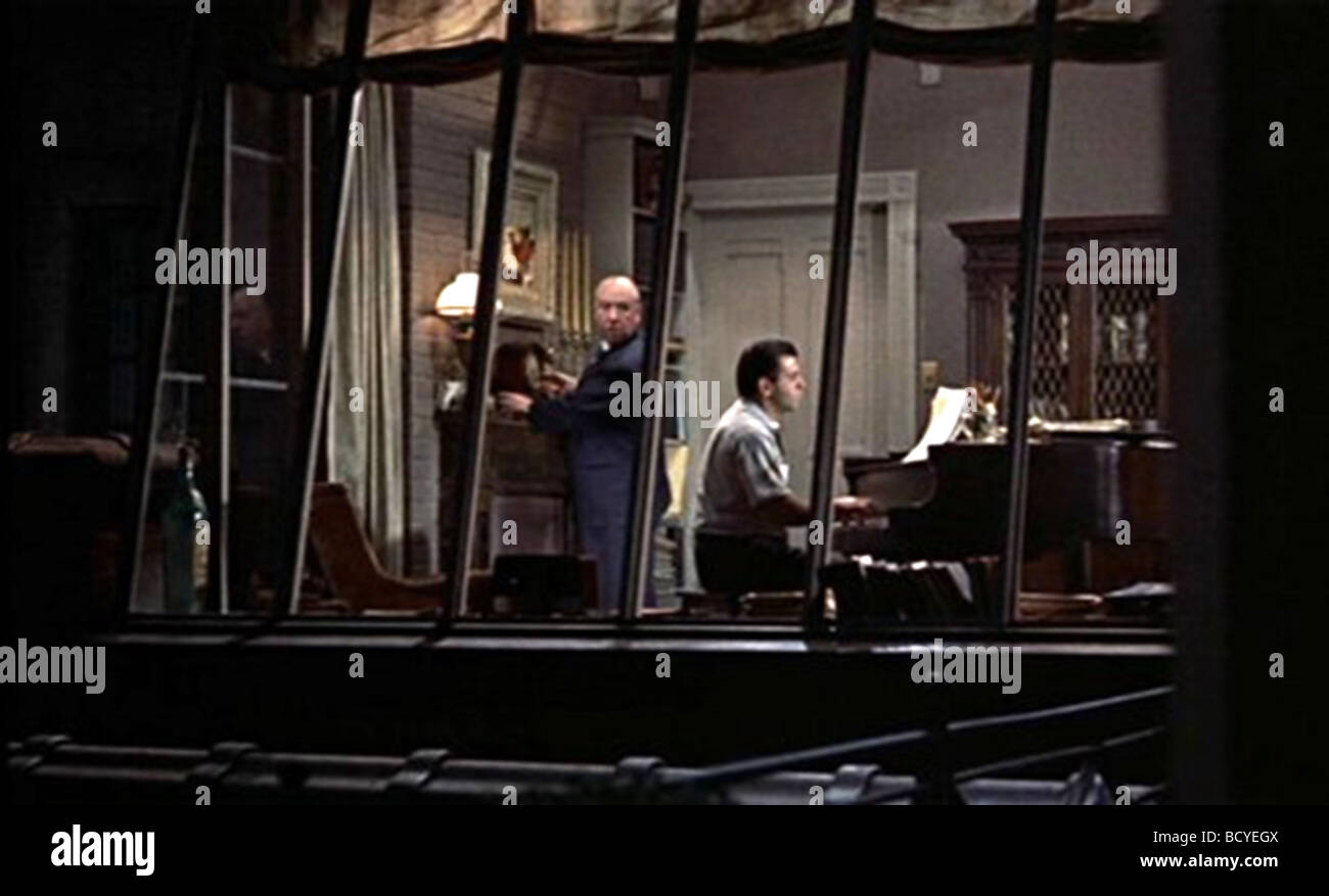 Rear Window Year : 1954 Director : Alfred Hitchcock Ross Bagdasarian - Stock Image