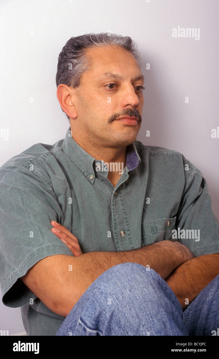 Middle Aged Indian Man Looking Depressed Stock Photo