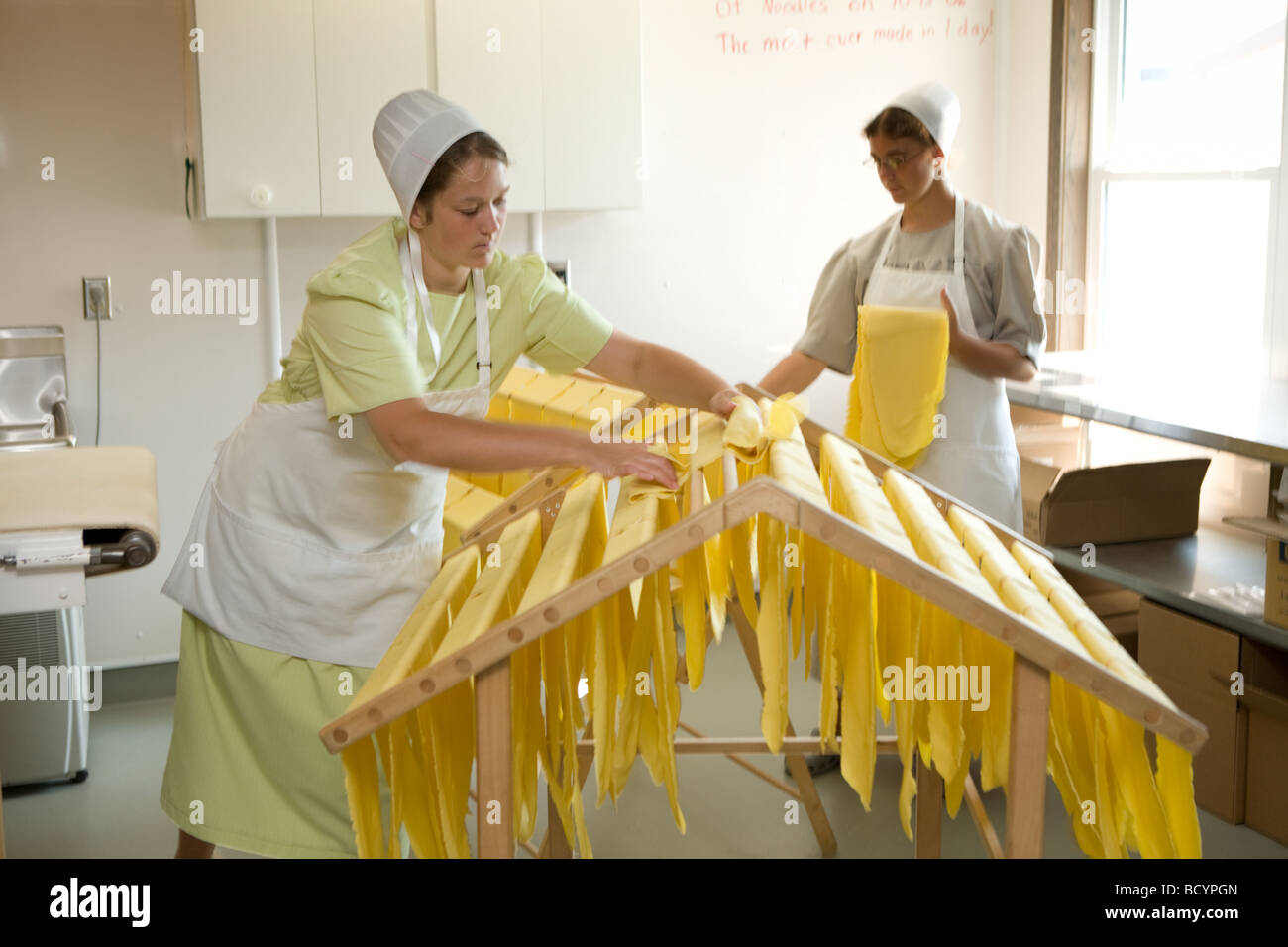 Amish women making egg noodles in Middlebury Indiana - Stock Image