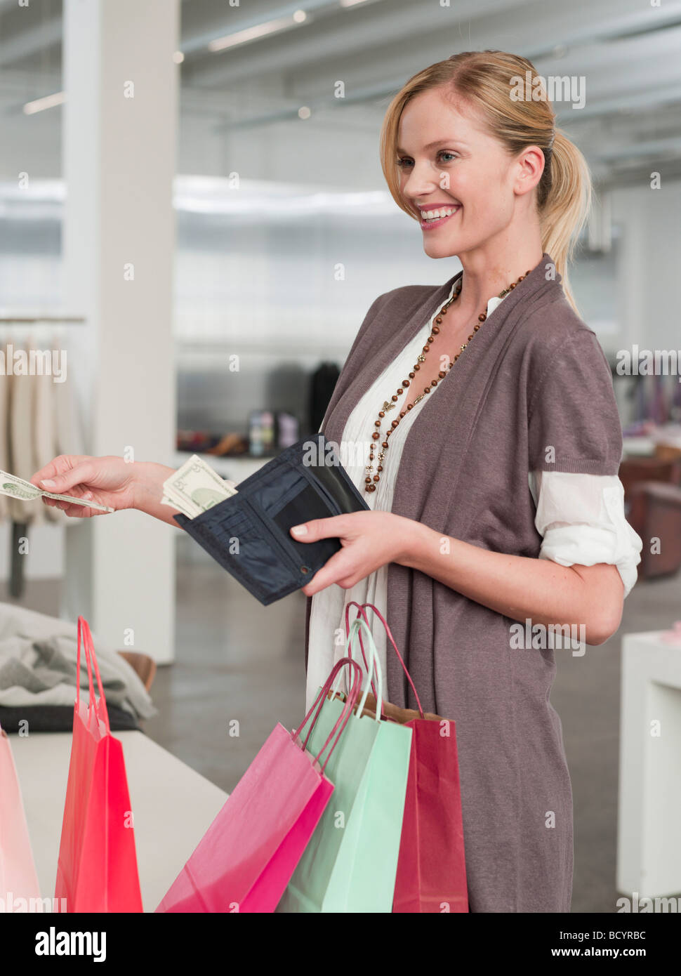 woman paying for her shopping items - Stock Image