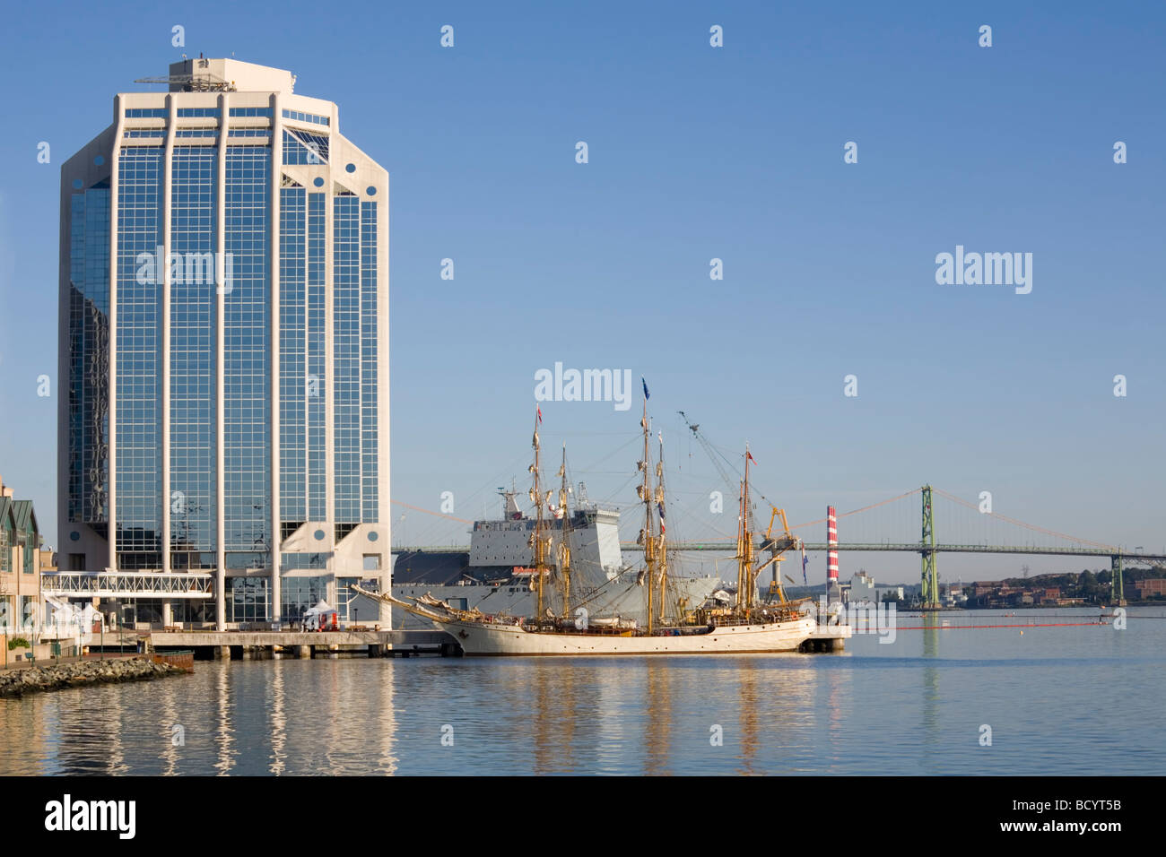 Tall ships docked in the early morning on Halifax s waterfront at Purdy s Wharf during the Nova Scotia Tall Ship Stock Photo
