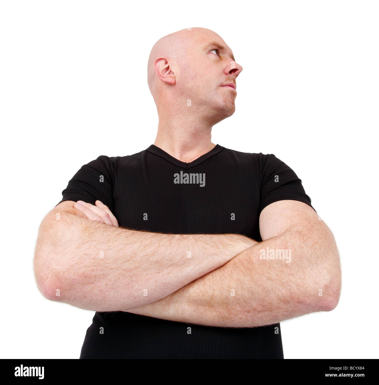 bald headed young bouncer - Stock Image