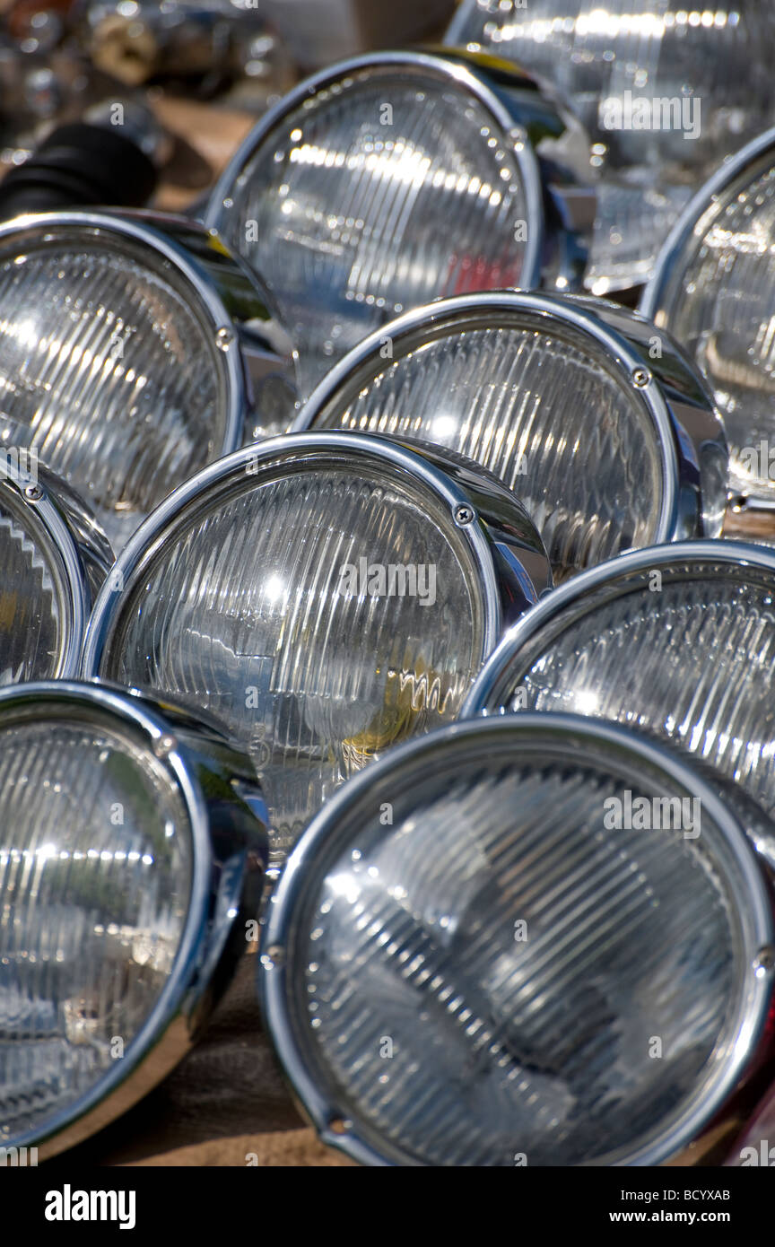 Rows of spare volkswagen headlights on an auto jumble stall at an enthusiasts meeting - Stock Image