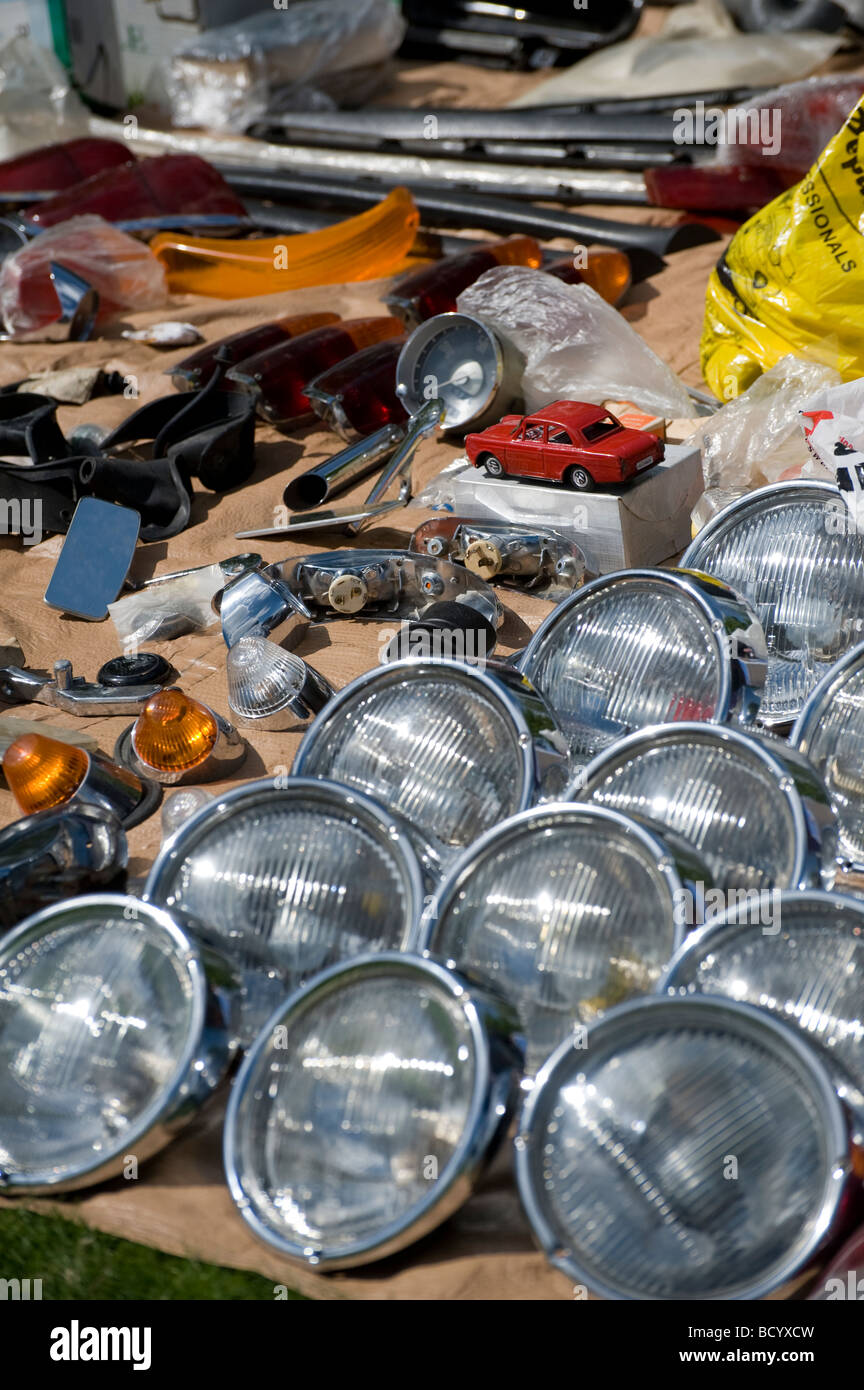 Rows of spare volkswagen headlights and car parts on an auto jumble stall at an enthusiasts meeting - Stock Image