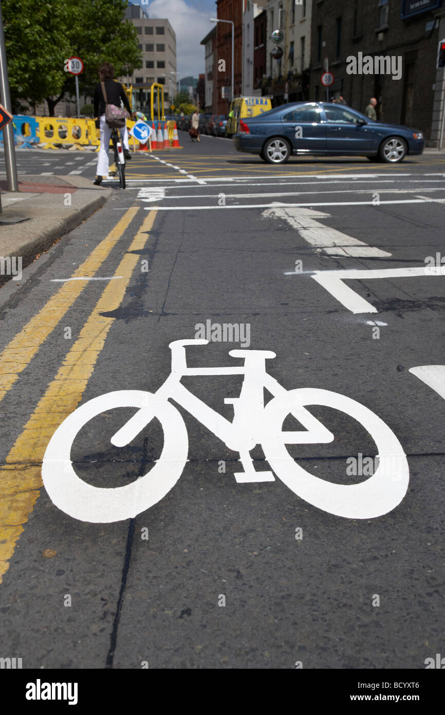 freshly painted cycle lane on a busy urban city road in dublin republic of ireland - Stock Image