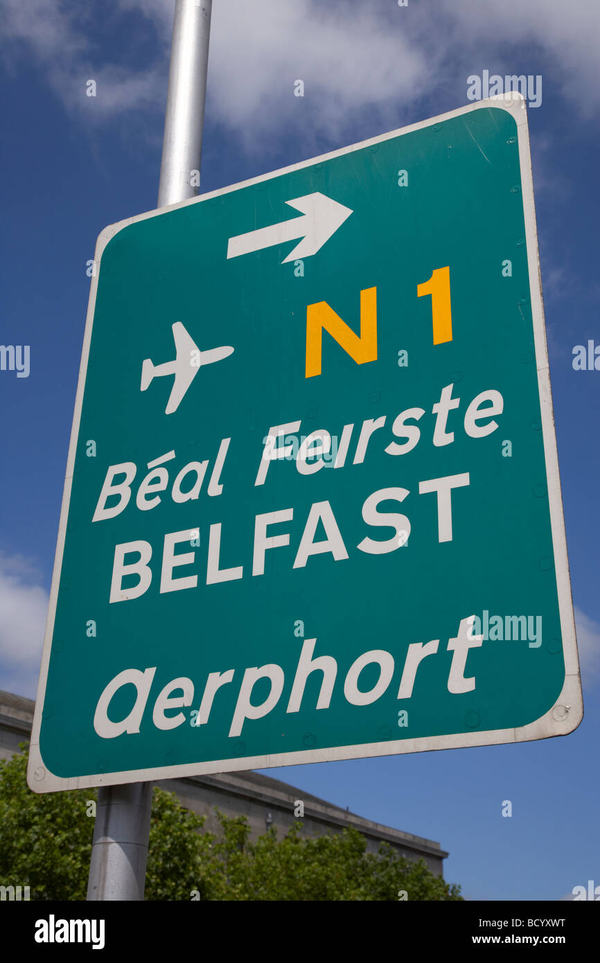 green sign in dublin city centre for belfast and the N1 road and airport in irish aerphort dublin republic of ireland - Stock Image