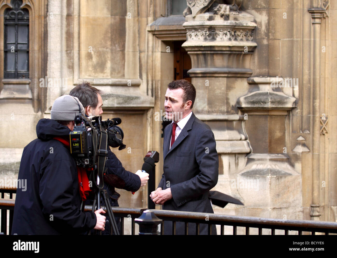 Adam Price, Plaid Cymru Member of Parliament for Carmarthen East and Dinefwr outside the Houses of Parliament Westminster - Stock Image