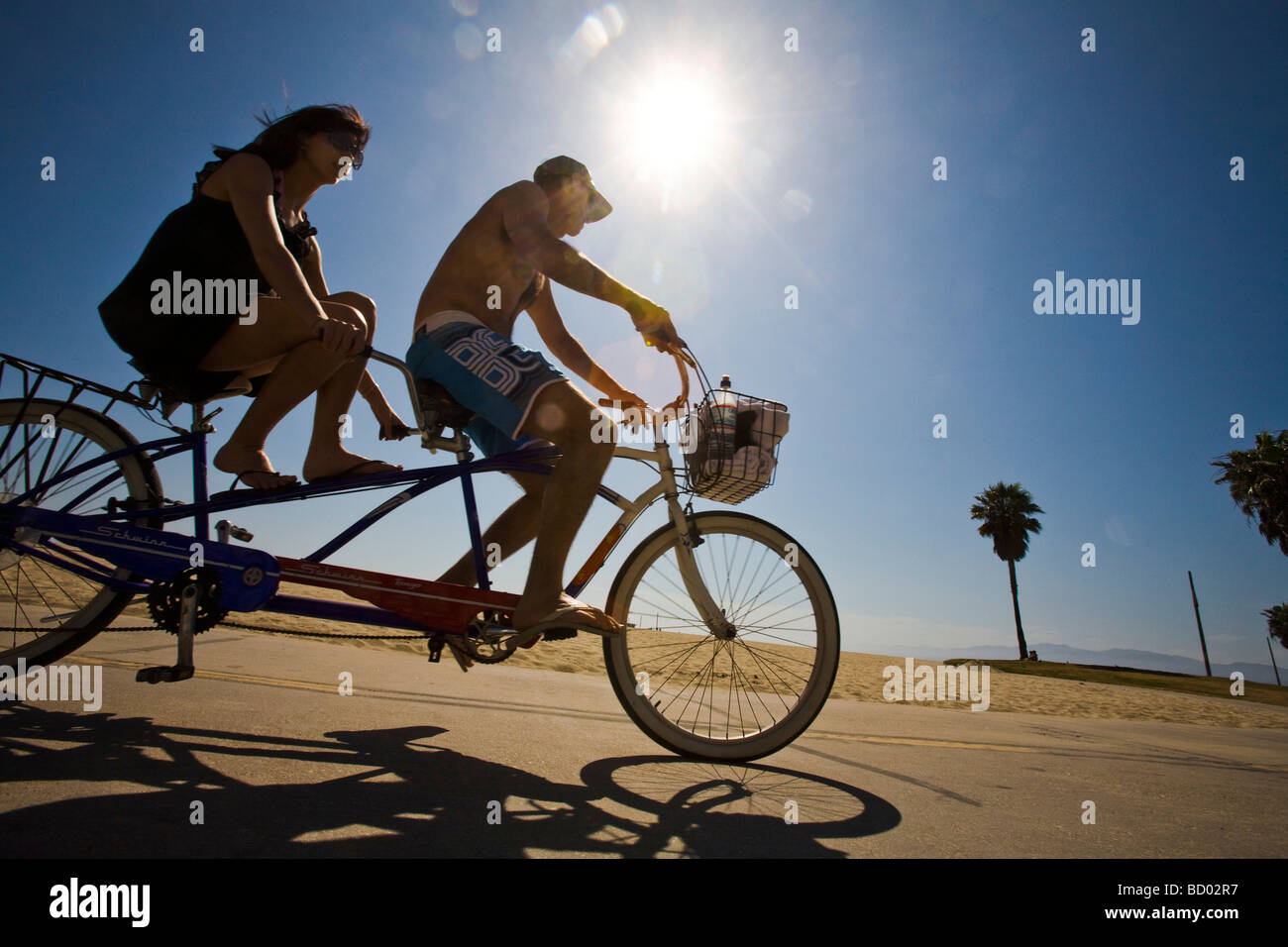 Tandem Bicycle riding Venice Beach Los Angeles County California United States of America - Stock Image