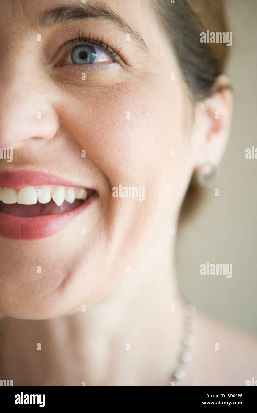closeup of a joyful, beautiful woman smiling - Stock Image