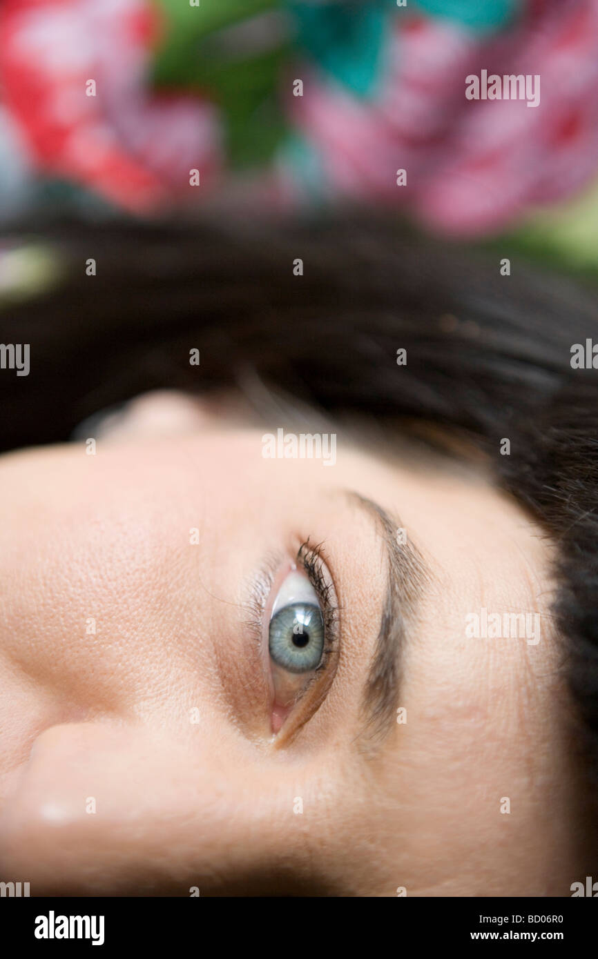 close up of woman's eye, wide awake, looking at camera - Stock Image