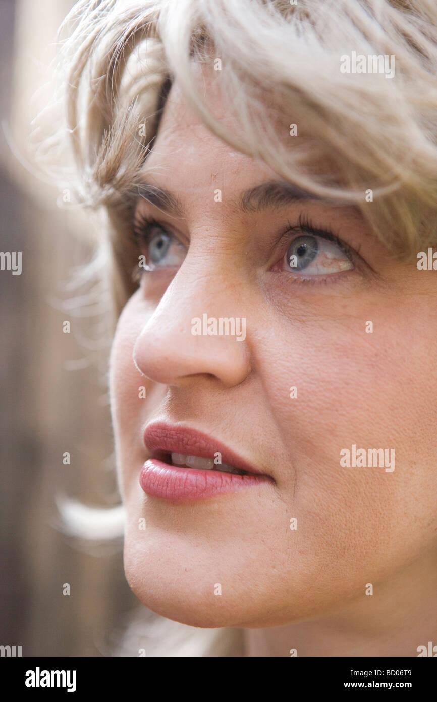 Closeup of woman looking up, sense of wonder - Stock Image