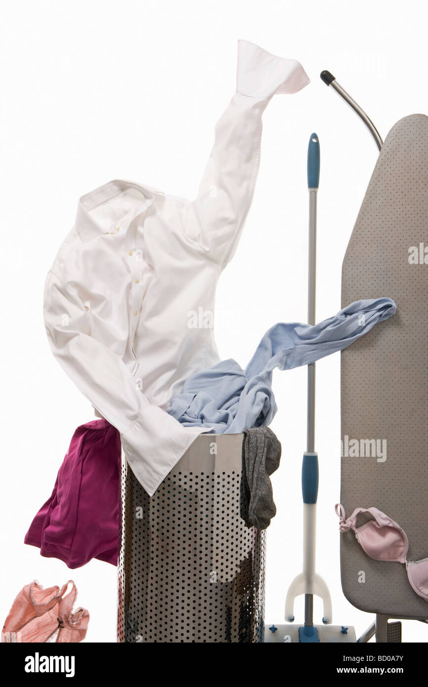A shirt emerging from the wash basket - Stock Image