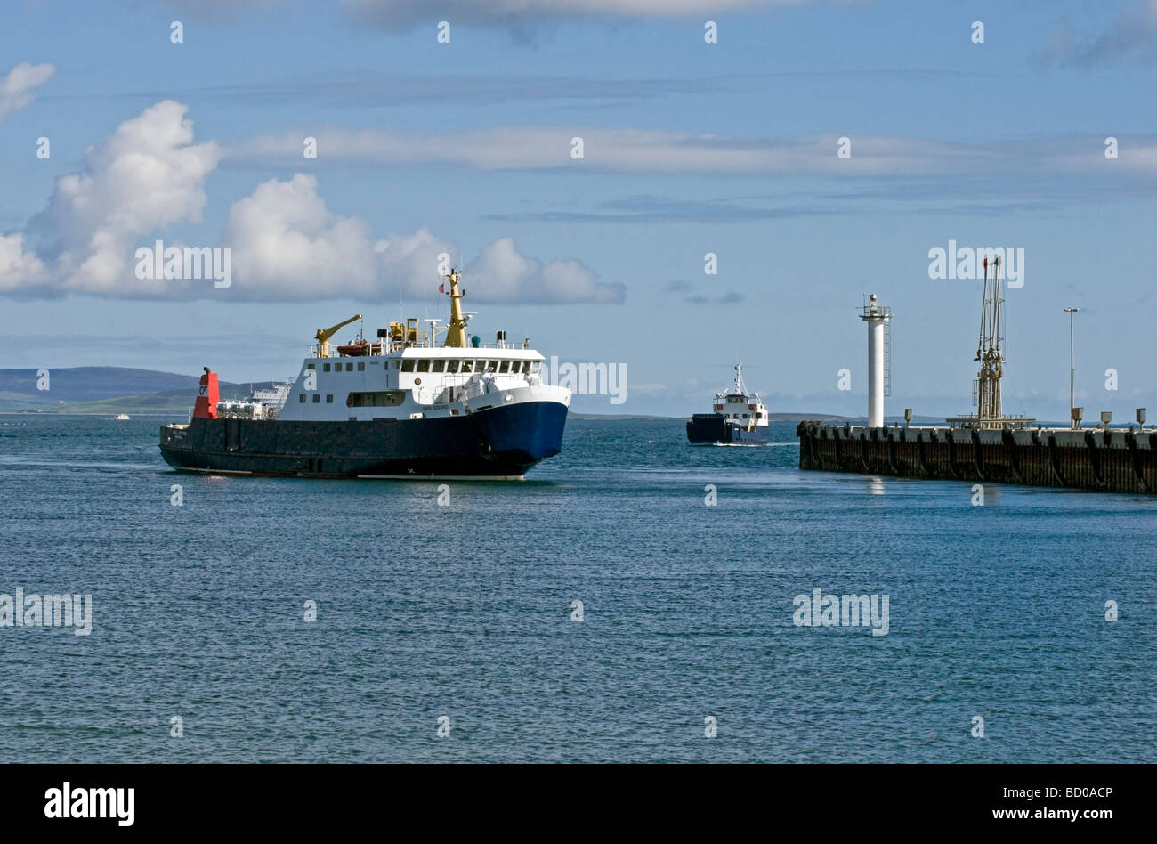 Car ferries Earl Sigurd and Sharpinsay returning to Kirkwall harbour in Orkney Scotland on a sunny June day. - Stock Image