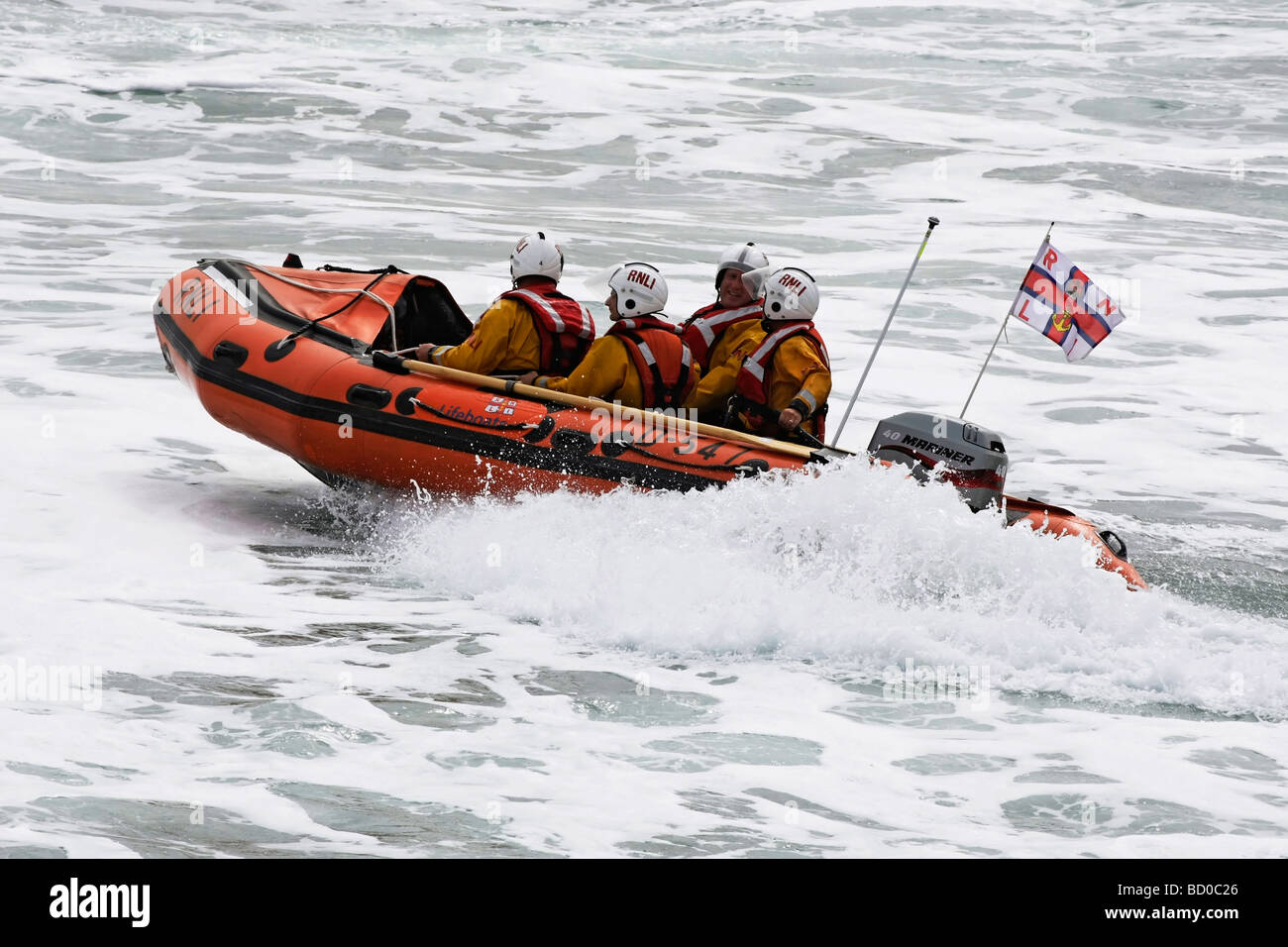 RNLI ILB D 547 crashing through the waves whilst practicing rescue and recovery drills - Stock Image