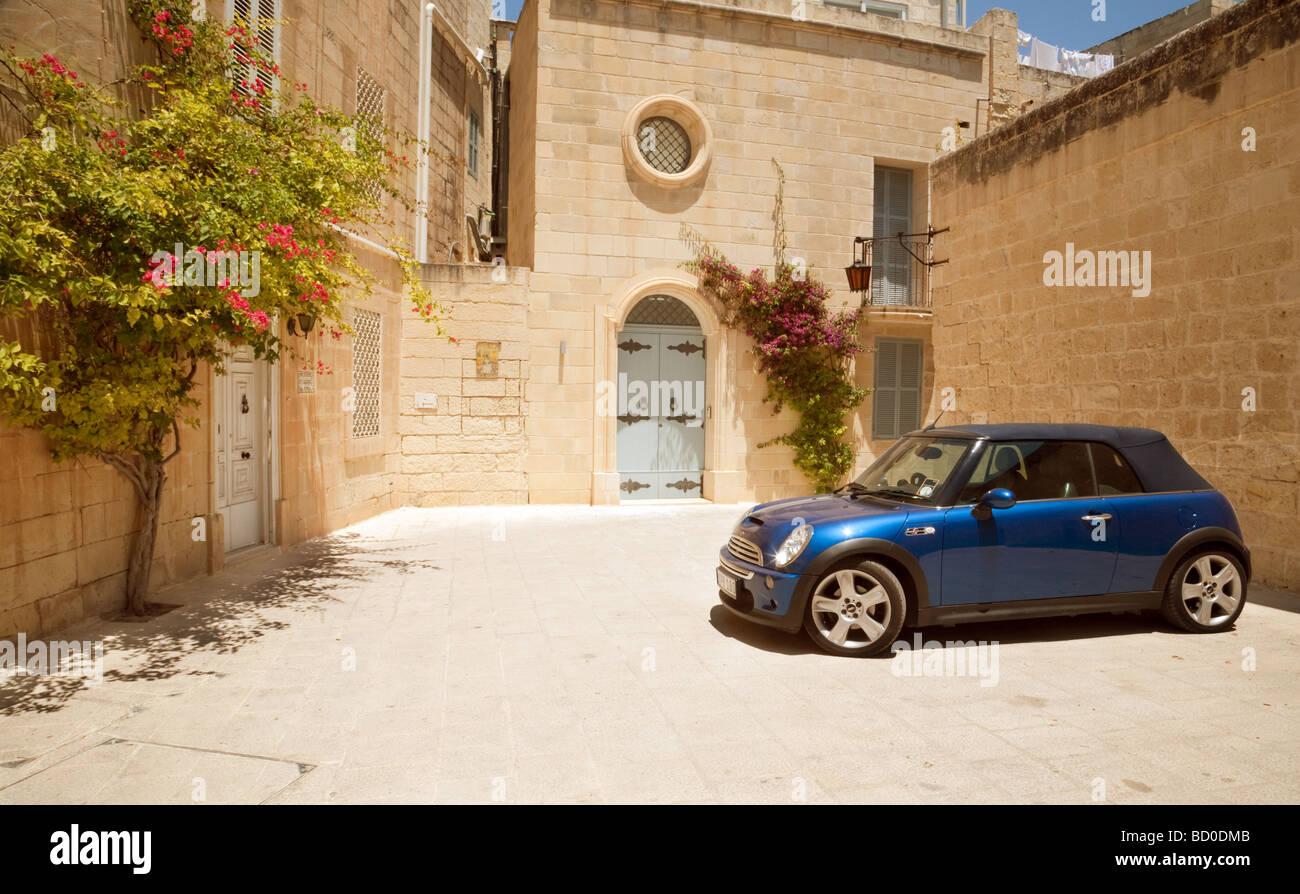 A  Mini Cooper parked outside a villa in Mdina, Malta - Stock Image