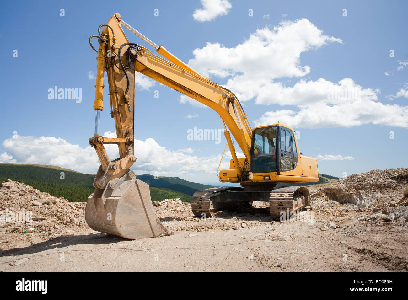 Excavator or digger construction machinery at a construction site outdoors Stock Photo