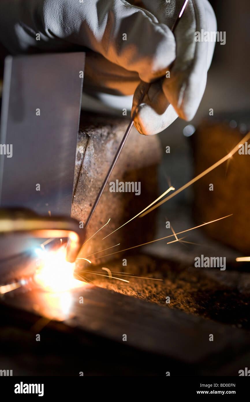 Airframe mechanic welding metal forms together, Spokane, Washington - Stock Image