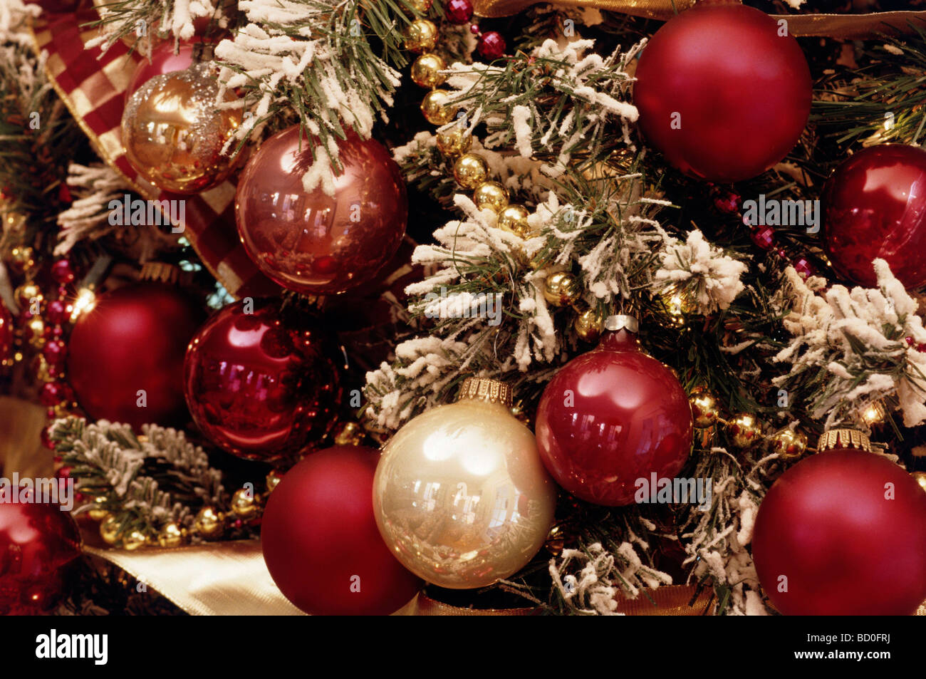 christmas ornaments on a snowy tree stock image - Large Christmas Tree Ornaments