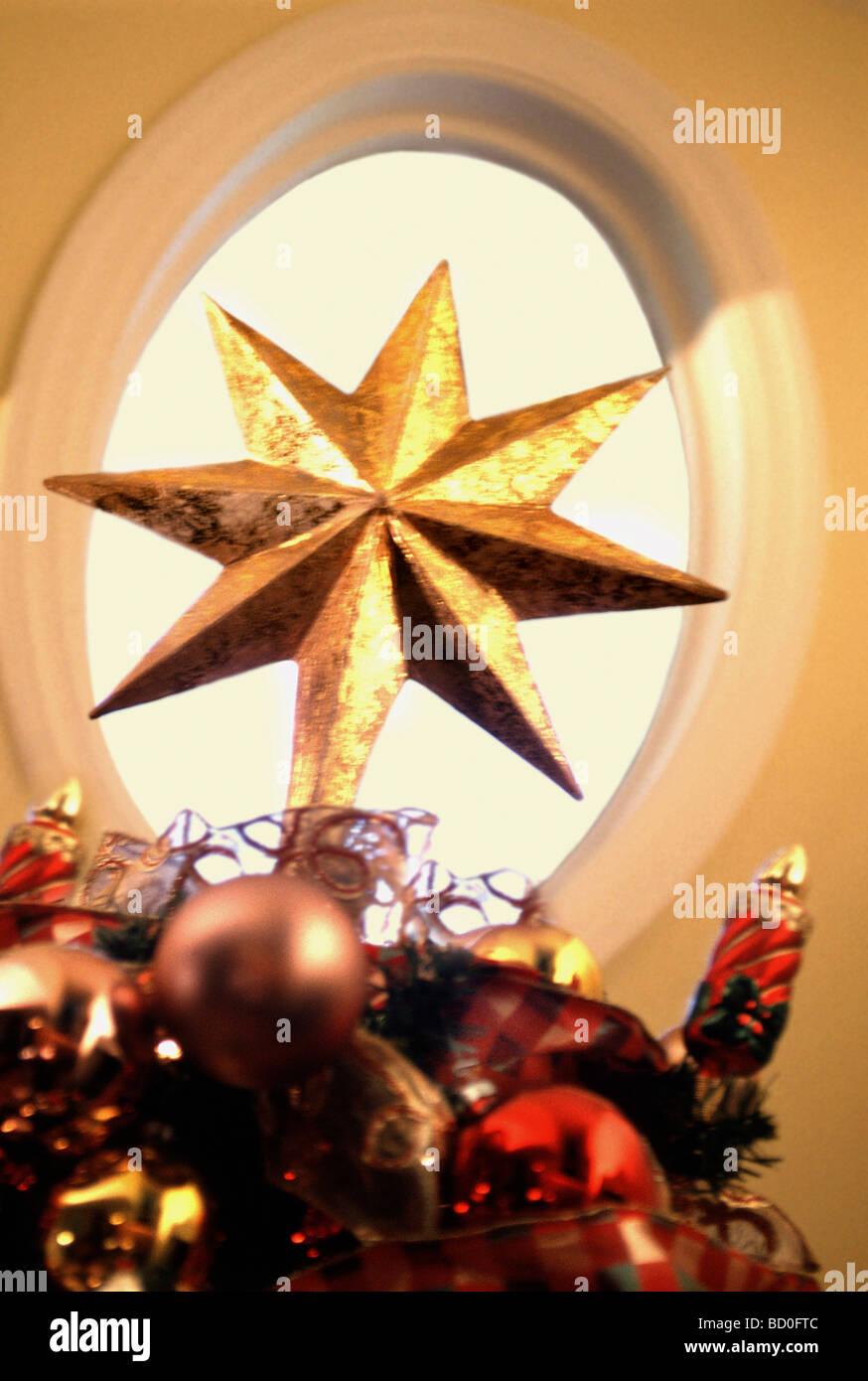 Gold Christmas ornament - Stock Image