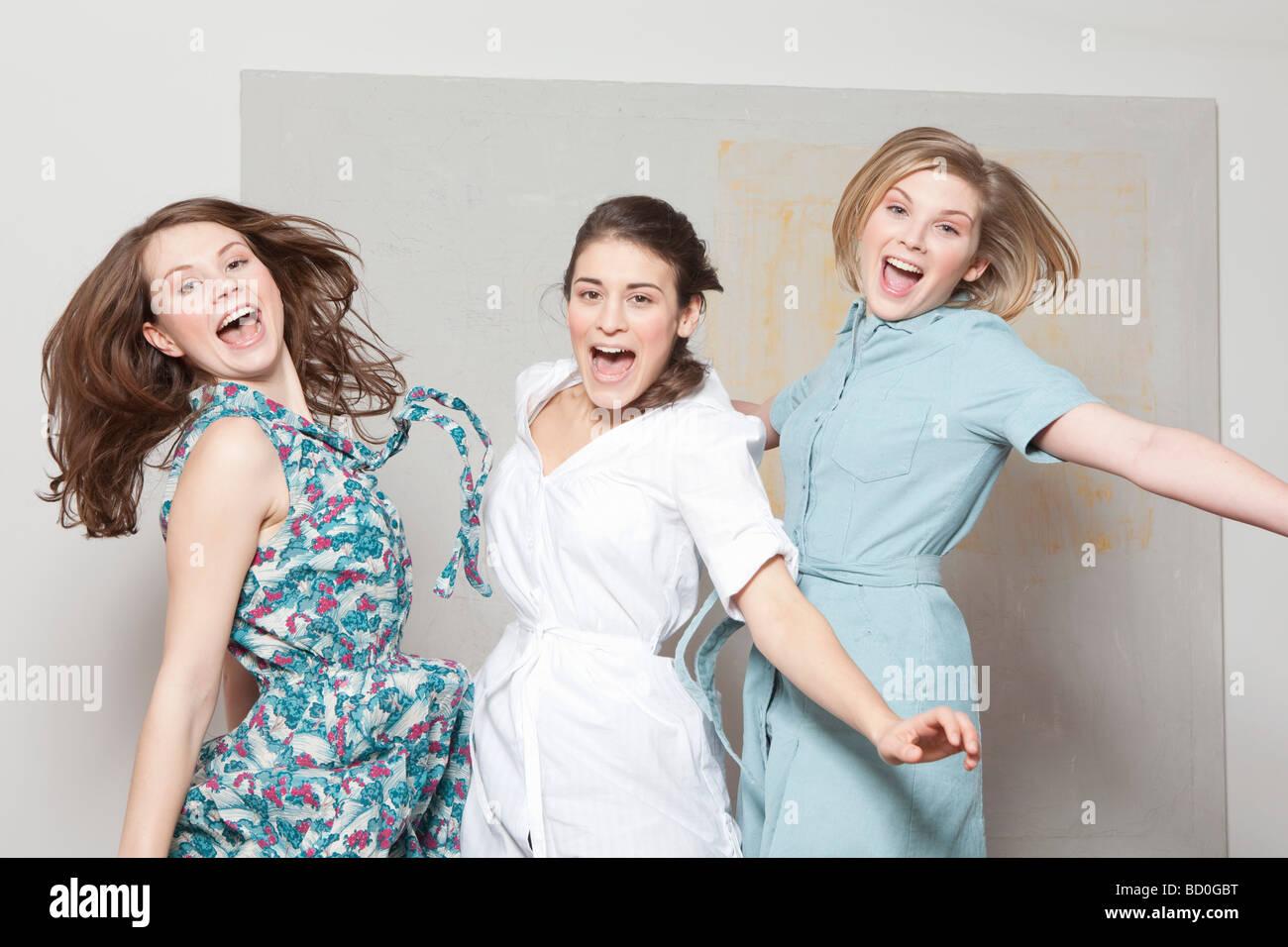 Three women jumping and jubilating Stock Photo