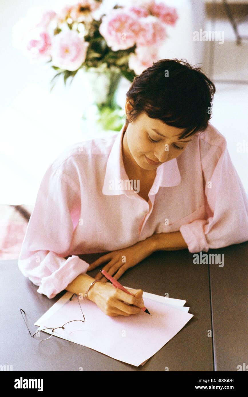 Woman preparing correspondence - Stock Image