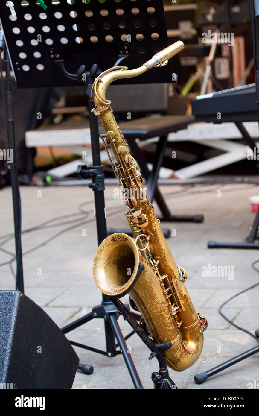 copper saxophone on stage ready for use - Stock Image