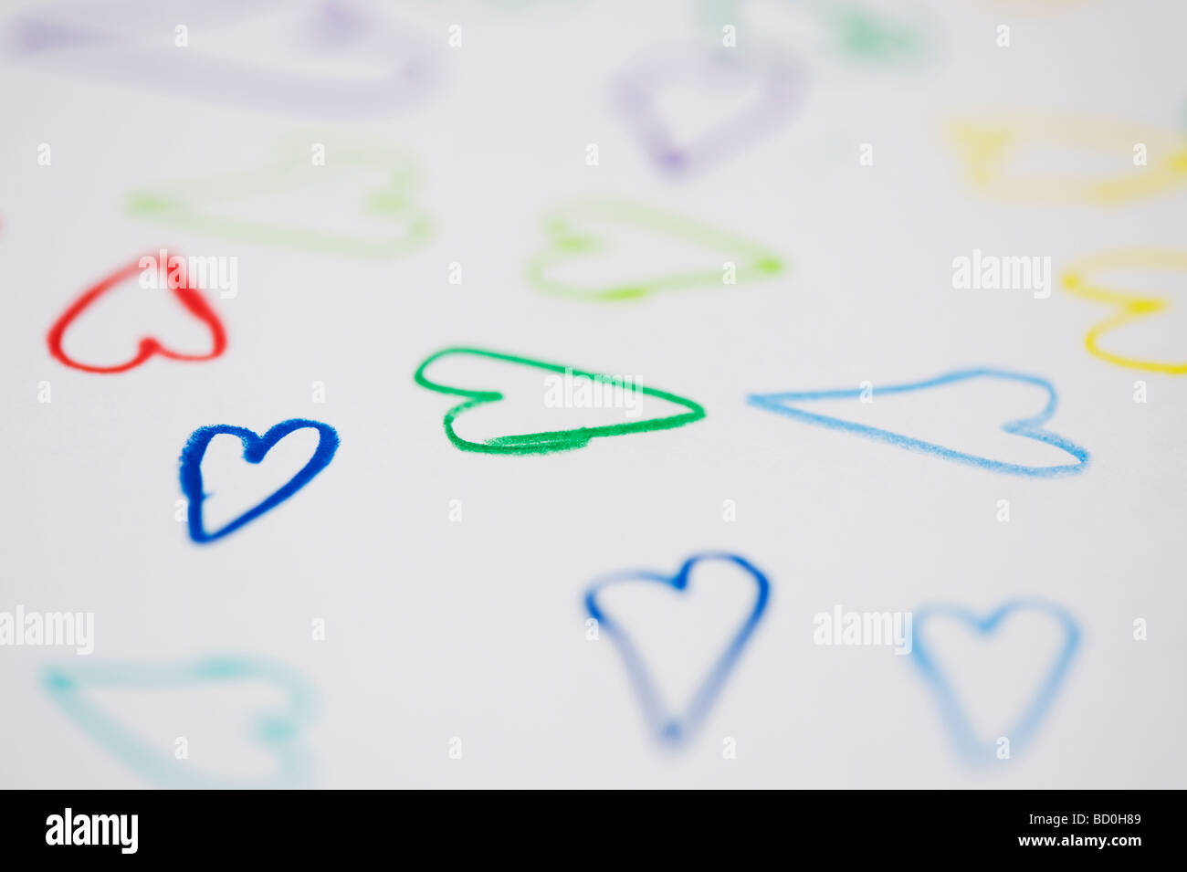 Childrens drawing of coloured love hearts on a piece of white paper - Stock Image