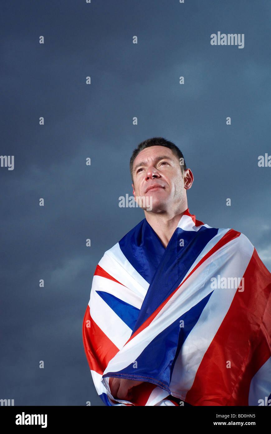 athlete wrapped in U.K. flag - Stock Image
