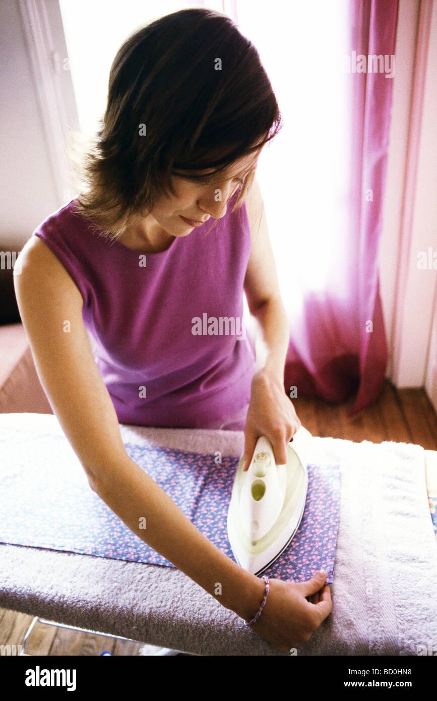 Woman ironing - Stock Image