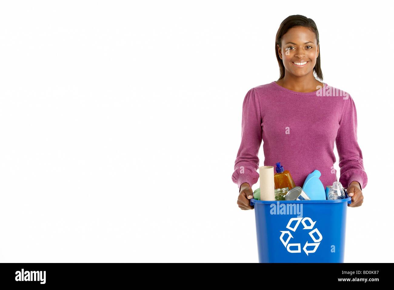 Woman Carrying Recycling Bin - Stock Image
