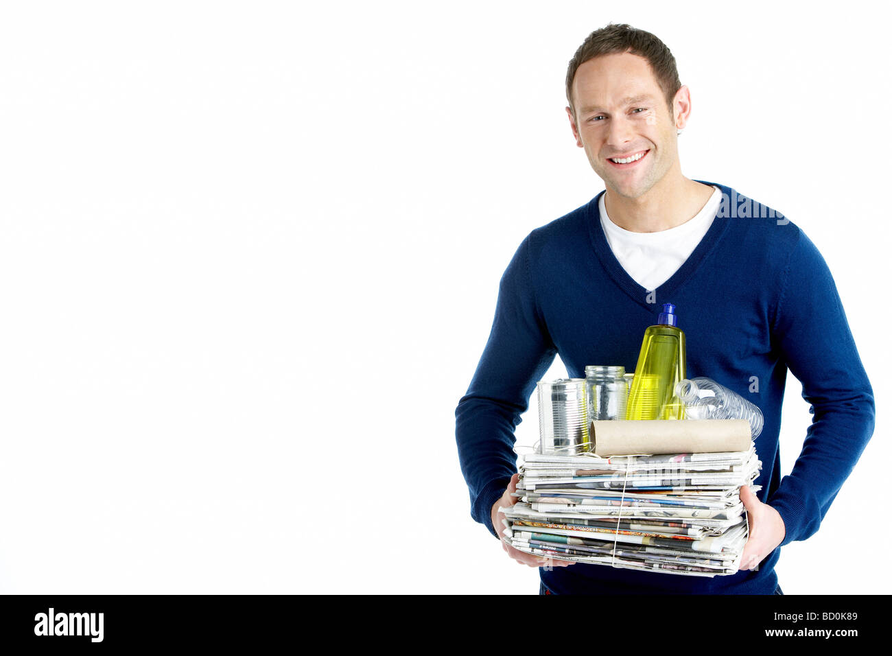 Man Carrying Stack Of Recycling - Stock Image