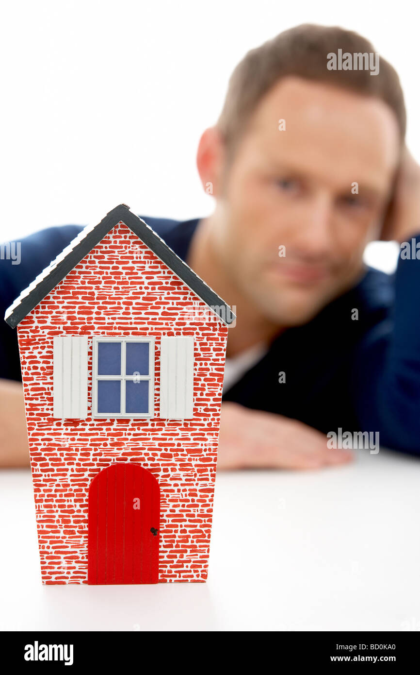 Man Looking At Model House - Stock Image