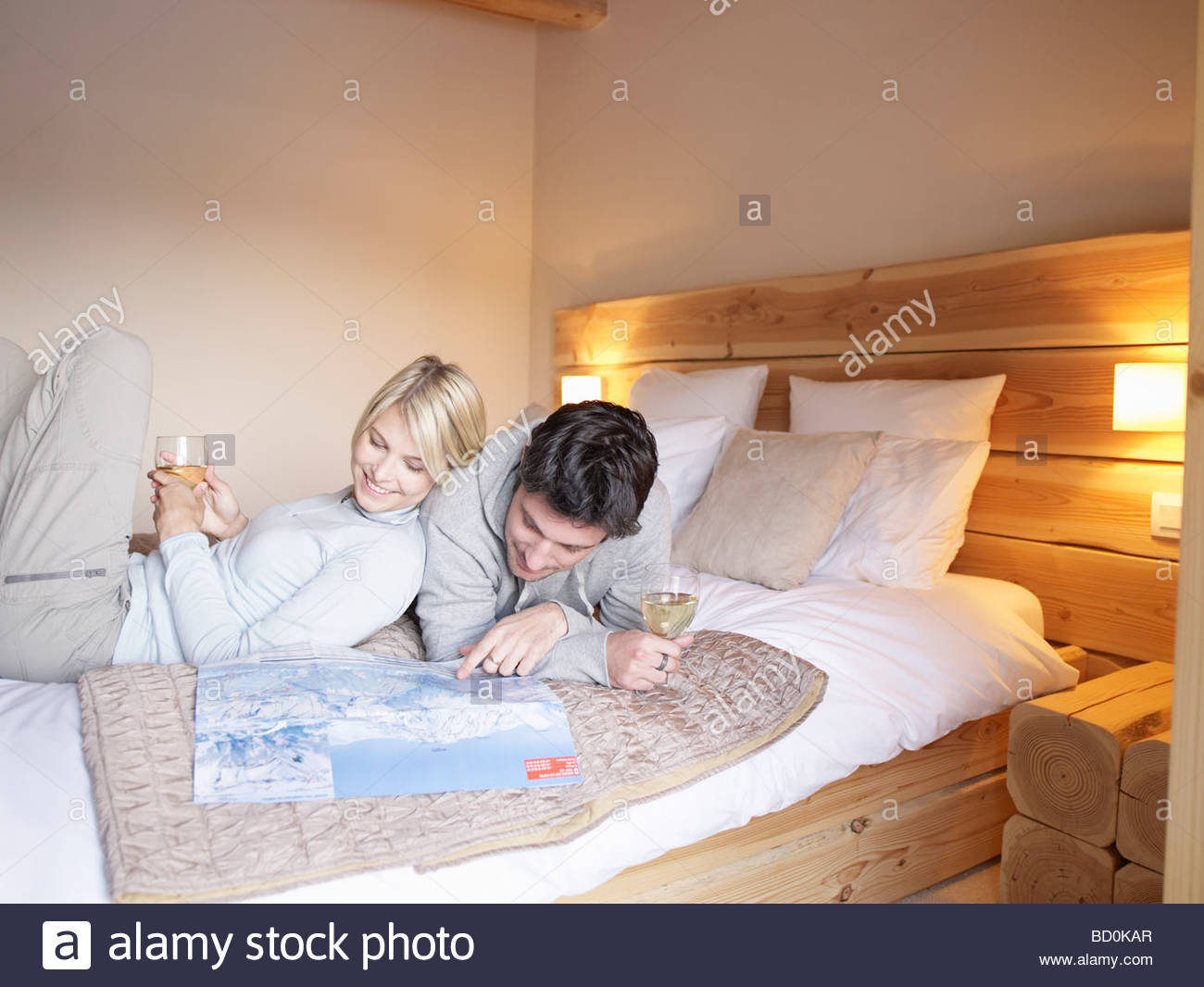 woman and man lying on reading map Stock Photo