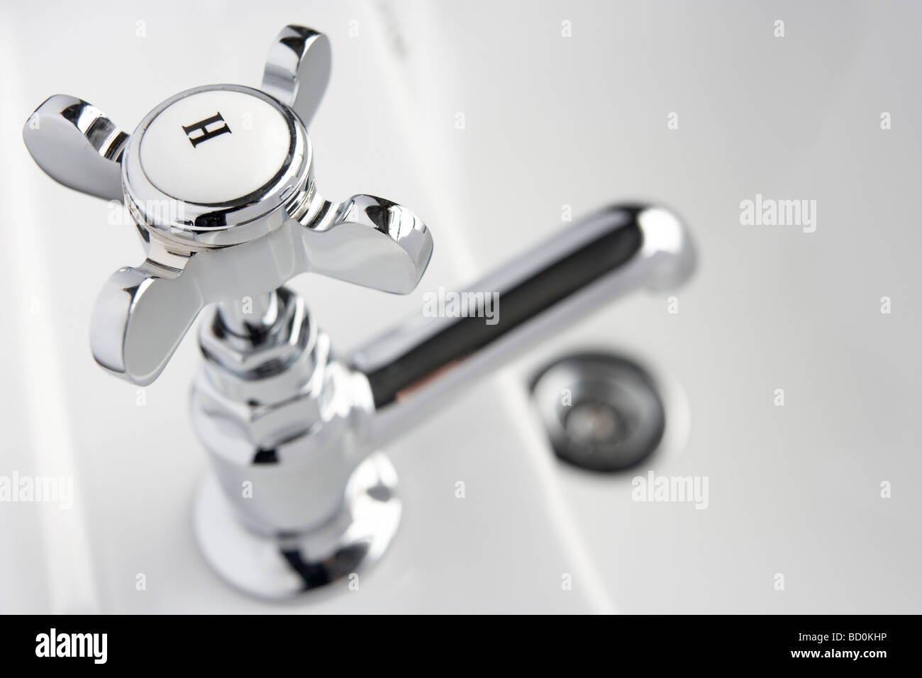 Hot Tap On Hand Basin - Stock Image