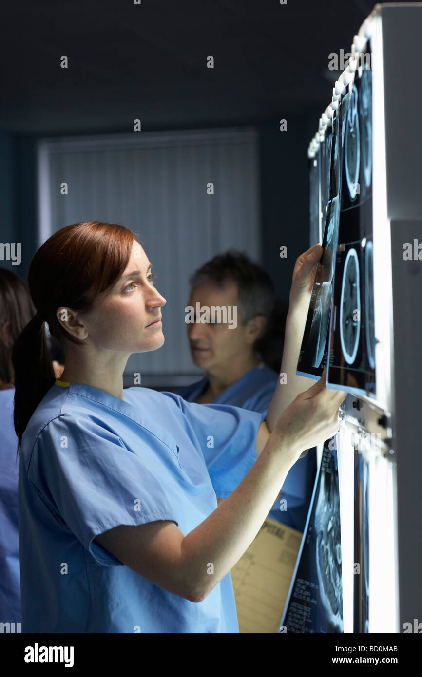 Doctor looking at x-rays - Stock Image
